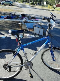 blue and white hardtail bike ]