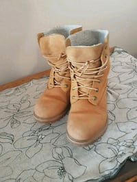 pair of brown leather work boots Winnipeg, R3M 1Y7