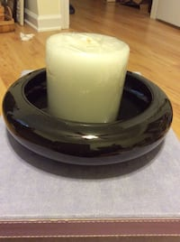 white pillar candle and black candle holder