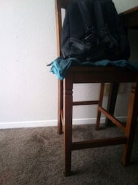 black wooden frame with brown padded chair Albuquerque, 87107