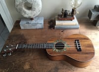 Beautiful, authentic ukulele from my travels to Hanoi, Vietnam. Paid $225 for it and has only been played a handful of times. Turns out I have no musical abilities whatsoever. Also, it comes with a black leather carrying bag. Arlington, 22202