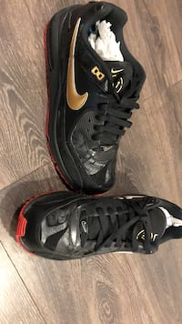 Pair of black-and-red nike sneakers