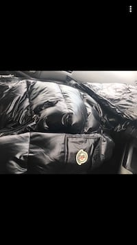 Black moncler jacket with tag