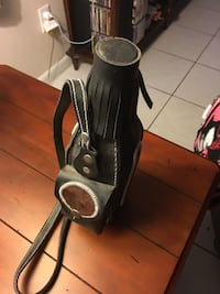 Black leather water container bag
