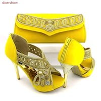 pair of yellow peep-toe platform stilettos Toronto, M9N 3S3