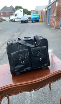 Professional suitcase with handles and wheels Baltimore, 21206
