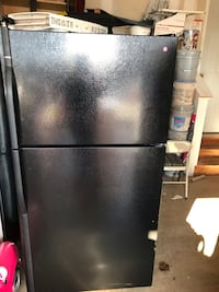 Black kenmore top freezer and bottom fridge with ice maker and water dispenser it's in good condition the dimensions is H 66 W 32/1/2 D 30 42 km