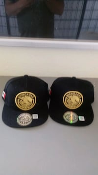 two black-and-yellow Michoacan fitted caps