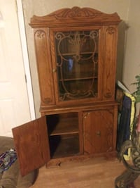 brown wooden framed glass display cabinet Albuquerque, 87108