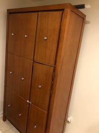 Brown wooden 4-door cabinet(unused)brand new Centreville, 20120