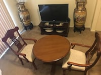 """3 piece dining set brown wood table 32"""" round 30"""" hight with 2 curved armchairs click on my profile picture on this page to check out my other listings message me if you interested pick up in Gaithersburg Maryland 20877 all sales final  Gaithersburg, 20877"""