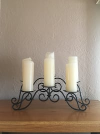Six white pillar candles and black metal candle holder Minneapolis, 55412