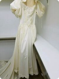 Designer wedding gown, beads, lace, was $600