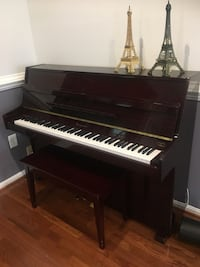 black and white upright piano