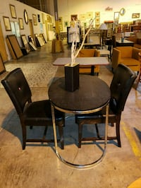 round brown wooden table with four chairs dining set North Las Vegas, 89081