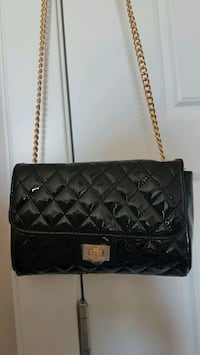 Shiny quilted black purse