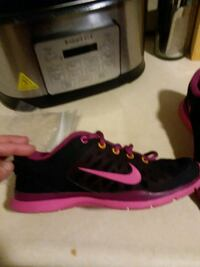 pair of black-and-pink Nike running shoes Youngstown