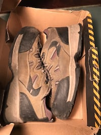 pair of brown-and-black Nike sneakers Montréal, H2K 3C2