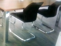 black and gray rolling armchair 1941 mi