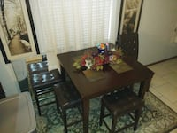 rectangular brown wooden table with four chairs dining set Panama City Beach, 32407