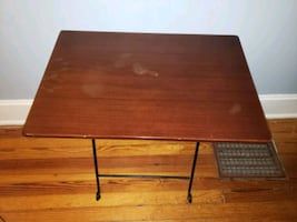 Table 24x16 inches wood and steel. Very sturdy and