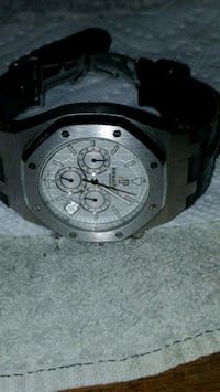 round silver chronograph watch with black strap Los Angeles, 90047