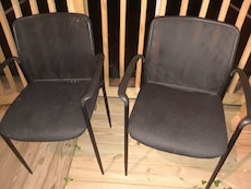 two black steel armchairs
