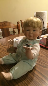 blond-haired baby doll with blue and white onesie