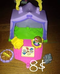 Green, pink, and purple plastic house toy 787 km