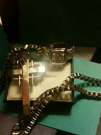 silver link silver rectangular skeleton watch,m silver necklace and silver cross pendant