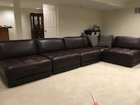 Dark brown sectional leather sofa with throw pillows Fairfax Station, 22039