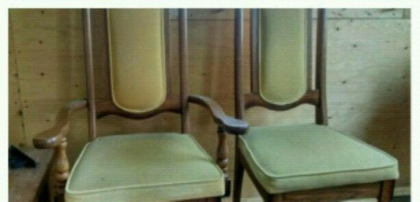brown wooden framed gold colored padded seats