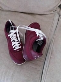 maroon-and-white Nike athletic shoes