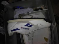 unpaired white and blue Reebok sneakers