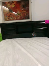 black wooden TV stand with flat screen television Omaha, 68134