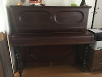 brown wooden upright piano TORONTO