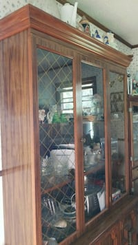 brown wooden framed glass display cabinet Cookeville, 38506