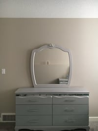 Silver wooden dresser with mirror and nightstand. In perfect condition.