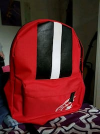 red and black adidas backpack 1313 km