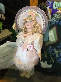 white and pink dressed porcelain doll null