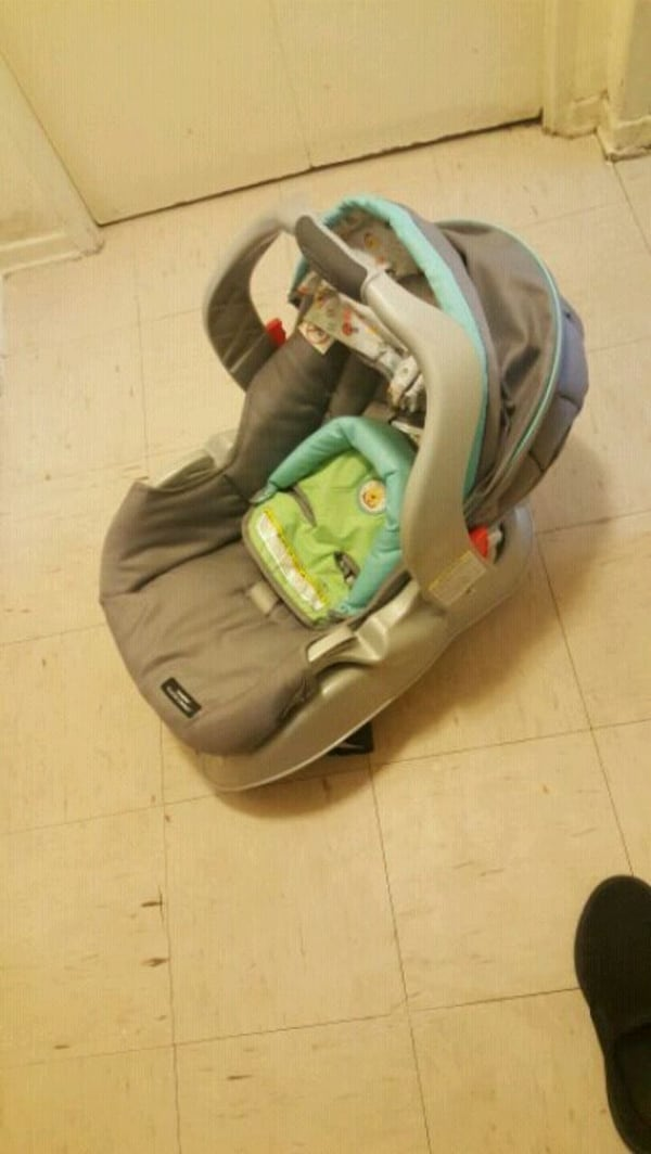 baby's gray and green car seat carrier. 01c60277-4652-46ef-8251-9493a22a9e04