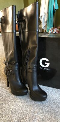 pair of black leather heeled boots Los Banos, 93635