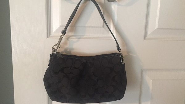 Used Authentic Black Coach Monogram purse  clutch for sale in Coconut Creek 29306f109db27