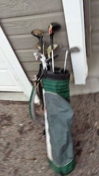 green and black golf bag with golf club set Denver, 80229