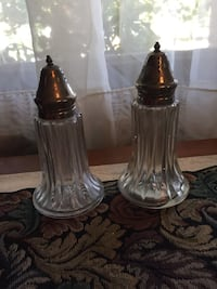 Two clear glass and  silver. condiment shakers Smyrna, 37167