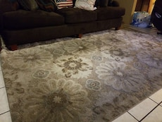 5+8 brown rug good condition