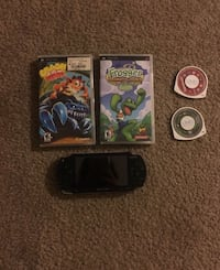 PSP with charger and four games  San Diego, 92127