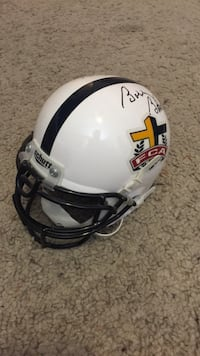 White fca mini helmet signed by bobby bowden and j.c. watts