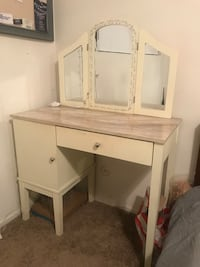 White wooden vanity table with mirror and lights
