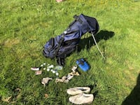 Black and gray golf bag with golf clubs Burnaby, V5H 3W3